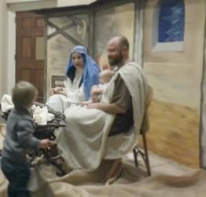 My son giving coins to baby Jesus