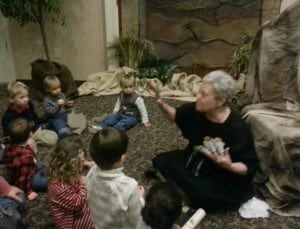 Enjoying a woman storyteller using hand puppets: Live Nativity Scenes in DFW